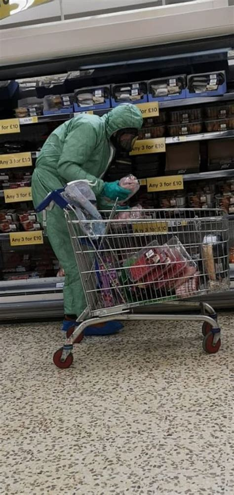 Shopper at UK Tesco spotted in full hazmat suit and gas