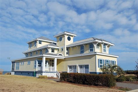 SOLD at auction : Waterfront Beach Home - Last List $1